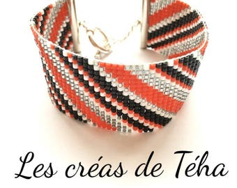 Very nice bracelet, black, white, grey and Red woven miyuki beads