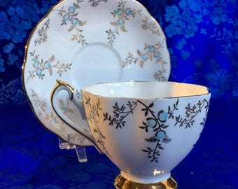 Queen Anne Gold and Turquoise Bone China Tea Cup and Saucer England