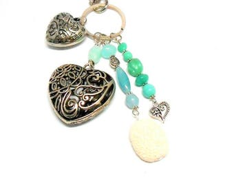 A scent! silver plated bag charm, heart green beads