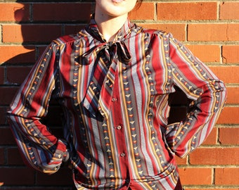 The Hippie Shake Blouse: 1960s Vintage Donovan Galvani of Dallas Retro Boho Brown Burgundy Pattern Button Up Bow Tie Bell Sleeve Blouse