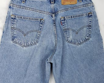 Vintage LEVIS 560 Loose Fit Tapered Leg 90s Light Wash Blue Jeans Mens 32x32, Tag 33