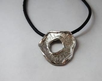Bronze pendant with patina