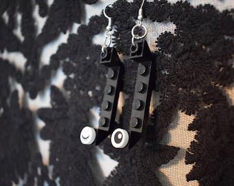 Black LEGO winking earring