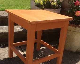 Orange painted side table