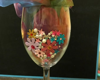 decorated handcrafted  flowers and heart wine glass