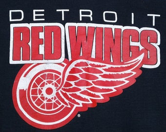 Vintage 80's / 90's Detroit Red Wings black and red crew-neck sweatshirt Fruit of the Loom Made in USA large