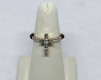 Crystal rhinestone cross stretch ring.  Size 7 to 9.  Rose gold, black, gold, and clear
