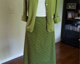 Green A-line cotton skirt with small darker green floral print. Size Large. Size 14.  Handmade USA.