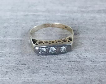 3 stone diamond ring in yellow and white gold