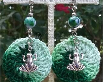 Green crochet frog themed earrings.