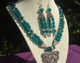 Emerald green beaded necklace set with oxidized pendant and matching earrings