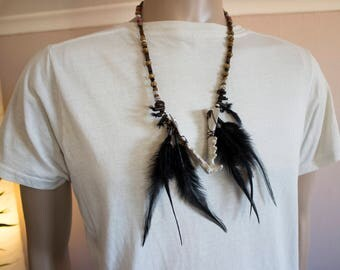 Resin bobcat jaw necklace with feathers