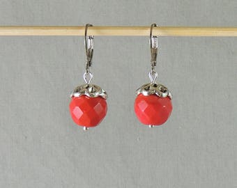 Earrings red faceted glass beads and silver metal
