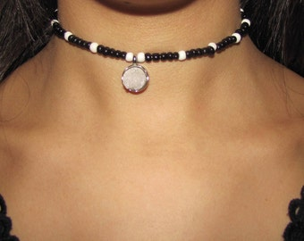 Black and white choker with a white rock