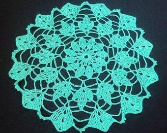 New turquoise crochet doily