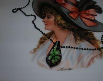 Green and black lampwork pendant