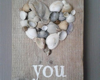 Scaffold wood wall decoration with shells heart Love You