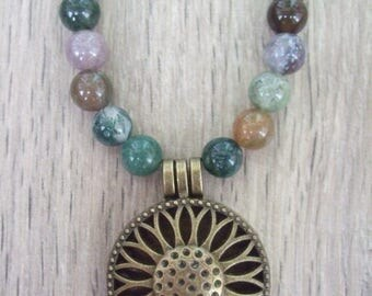 Indian glass agate beads with antique bronze pendant