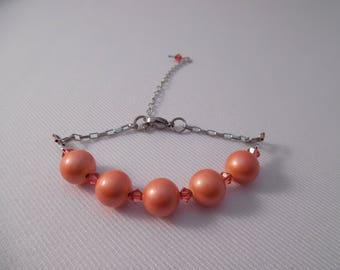 Bracelet with gemstone and swarovski, salmon, stainless steel chain.
