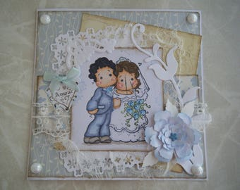 With a couple of bride and groom wedding card