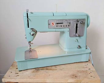 Vintage Singer 338 Pastel Sewing Machine with case, pedal and instruction manual. Working condition.