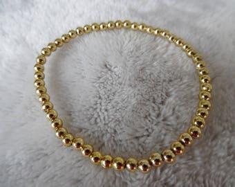 small gold tone beaded bracelet