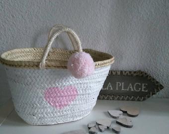 Pink basket/bag of white beach, heart and tassel