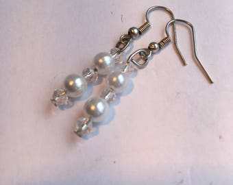 Pearl and crystal bead drop earrings.