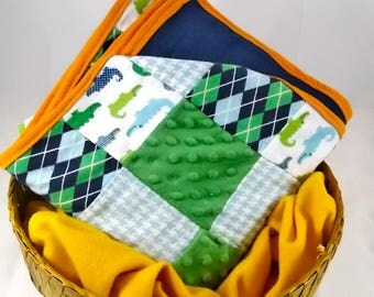Blue, white, and green cotton patchwork and minky alligator lovey blanket