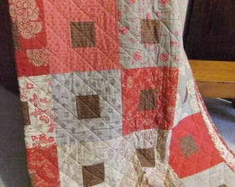 Red square-in-square quilt
