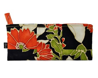 Clutch in red, green, black, and white floral