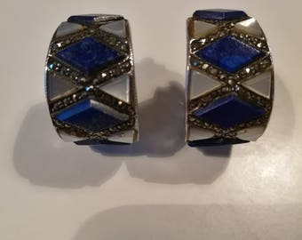 Vintage earrings from the 80's. These are made of solid silver, mother of pearl, lapis lazuli.