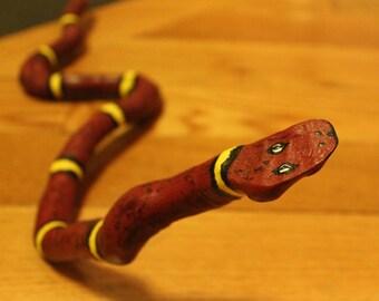 Painted stick snake, wooden snake, branch snake, driftwood snake
