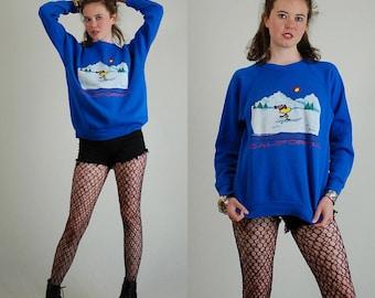 PEANUTS Sweatshirt Vintage 70s 80s Blue PEANUTS Charles Schulz Woodstock Distressed Slouchy Pullover Sweatshirt (s m)
