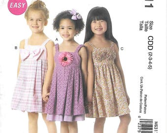 McCalls M6311 UNCUT Girls Sundress with Bow or Flower Detail Sewing Pattern Sizes 2 to 5