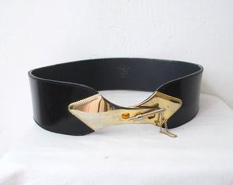 Unique vintage glossy leather belt with metal closure. wide waist belt. modernist belt