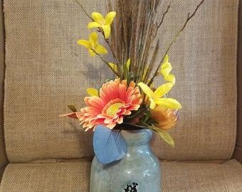 Darling fall silk floral arrangement in vintage style blue milk jug.