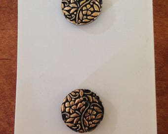 Set of two floral relief metal buttons