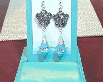 Silver and blue bird with czech and lucite flower earrings. Sterling silver earring hooks