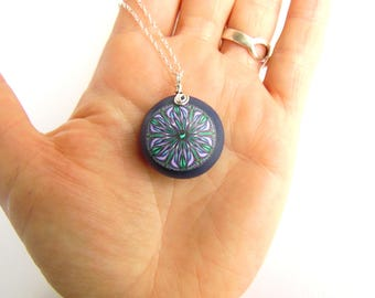 Small Navy Blue Pebble Pendant with Intricate Lilac Millefiori Flower Design, Sterling Silver Chain. Handmade by Supremily Jewellery