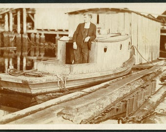 Man on His LITTLE TUG BOAT At the Harbor Dock Photo Postcard circa 1910