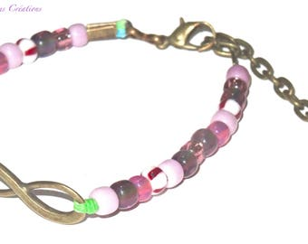 Bronze bracelet infinite symbol and lilac, plum and transparent rocailles, Czech glass, bronze