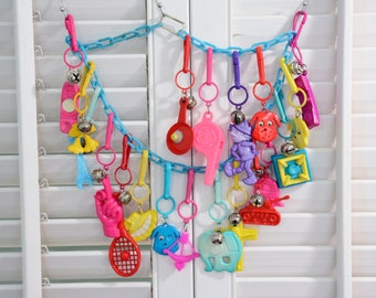 Awesome Rad 80's Plastic Bell Charm Necklace - Every 80's Kid Dream! 19 Charms and Blue Chain - Tennis Racket, Dog, Stove, Phone, Hand, Tank