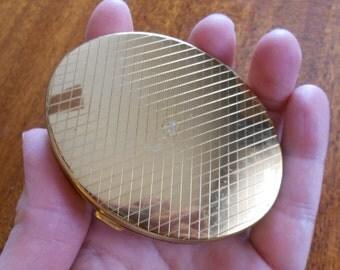 Vintage gold compact.  Powder case.