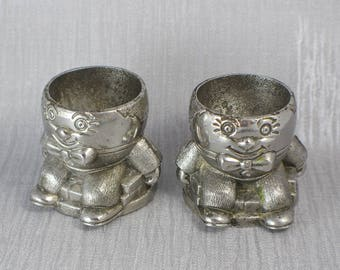 A Rough Pair of Silver Tone Small Humpty Dumpty Themed Egg Cups