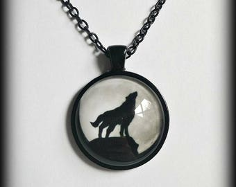 Gothic wolf moon glass cameo necklace.
