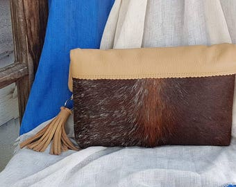 GYR Brahman cowhide clutch with cappuccino Italian leather trim and floral print lining handmade on farm by HIDE4350.