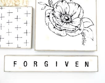 forgiven block lettering black and white rustic wood sign