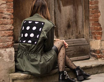 Green coat with polka dolt