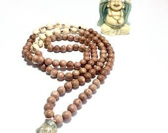 Japa Mala or meditation necklace, Tenderness, youth and happiness, rosewood, acai seeds, zebra jasper, pearl enamelled at the head of Boudha